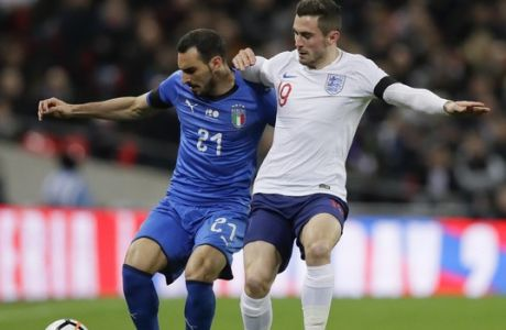 Italy's Davide Zappacosta, left, is challenged by England's Lewis Cook during the international friendly soccer match between England and Italy at the Wembley Stadium in London, Tuesday, March 27, 2018. (AP Photo/Kirsty Wigglesworth)