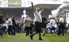 Fans invade the pitch after the English Premier League soccer match between Tottenham Hotspur and Manchester United at White Hart Lane stadium in London, Sunday, May 14, 2017. It was the last Spurs match at the old stadium, a new stadium is being built on the site. (AP Photo/Frank Augstein)