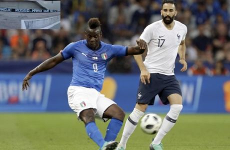 Italy's Mario Balotelli, left, kicks the ball while France's Edil Rami looks on during a friendly soccer match between France and Italy at the Allianz Riviera stadium in Nice, southern France, Friday, June 1, 2018. (AP Photo/Claude Paris)