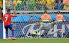 BELO HORIZONTE, BRAZIL - JUNE 28:  Julio Cesar of Brazil saves the penalty shot of Alexis Sanchez  of Chile in a shootout during the 2014 FIFA World Cup Brazil round of 16 match between Brazil and Chile at Estadio Mineirao on June 28, 2014 in Belo Horizonte, Brazil.  (Photo by Buda Mendes/Getty Images)