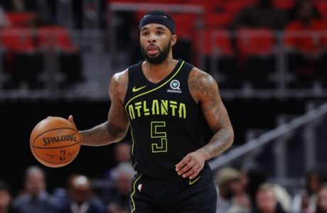 Atlanta Hawks guard Malcolm Delaney (5) plays against the Detroit Pistons in the first half of an NBA basketball game in Detroit, Wednesday, Feb. 14, 2018. (AP Photo/Paul Sancya)
