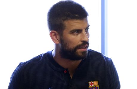 FC Barcelona's Gerard Pique arrives for a press conference at the Sports Center FC Barcelona Joan Gamper in Sant Joan Despi, Spain, Saturday, Aug. 12, 2017. FC Barcelona will play against Real Madrid in the first leg of Spanish Supercup next Sunday. (AP Photo/Manu Fernandez)