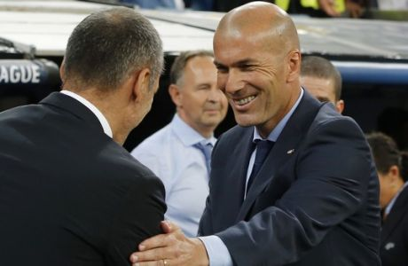 Real Madrid coach Zinedine Zidane, right, shakes hands with APOEL Nicosia coach Giorgos Donis before the Champions League group H soccer match between Real Madrid and Apoel Nicosia at the Santiago Bernabeu stadium in Madrid, Spain, Wednesday, Sept. 13, 2017. (AP Photo/Paul White)