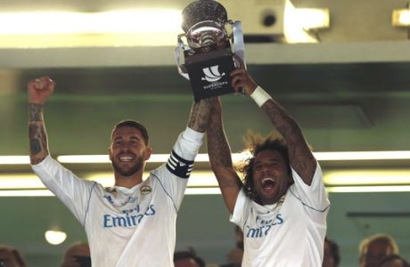 Real Madrid's captain Sergio Ramos, left, and Marcelo lift up the trophy after winning the Spanish Super Cup against Barcelona at the Santiago Bernabeu Stadium in Madrid, Thursday, Aug. 17, 2017. Real Madrid won 5-1 on aggregate. (AP Photo/Francisco Seco)