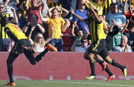 Watford's Craig Cathcart, 2nd right, celebrates with Troy Deeney, right, after scoring his side's second goal during the English Premier League soccer match between Watford FC and Tottenham Hotspur at Vicarage Road stadium in Watford, England, Sunday, Sept 2, 2018. (AP Photo/Frank Augstein)