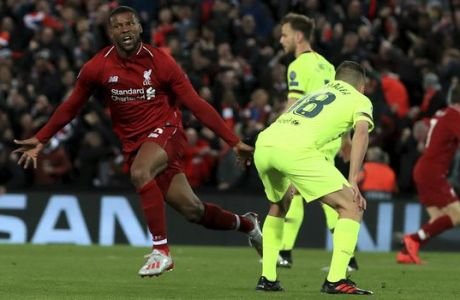 Liverpool's Georginio Wijnaldum, left, celebrates scoring his side's third goal of the game during the Champions League Semi Final, second leg soccer match between Liverpool and Barcelona at Anfield, Liverpool, England, Tuesday, May 7, 2019. (Peter Byrne/PA via AP)