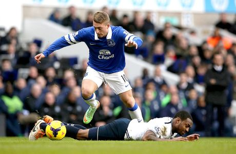 Tottenham's Danny Rose, lies on the ground after being fouled by Everton's Gerard Deulofeu during the English Premier League soccer match between Tottenham Hotspur and Everton at the White Hart Lane stadium in London, Sunday, Feb. 9  2014. (AP Photo/Alastair Grant)