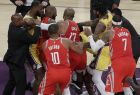 Houston Rockets' Chris Paul, second from left, is held back by Los Angeles Lakers' LeBron James, left, as Paul fights with Lakers' Rajon Rondo, center obscured, during the second half of an NBA basketball game Saturday, Oct. 20, 2018, in Los Angeles. The Rockets won, 124-115. (AP Photo/Marcio Jose Sanchez)