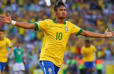 FORTALEZA, BRAZIL - JUNE 19:  Neymar of Brazil celebrates scoring the opening goal during the FIFA Confederations Cup Brazil 2013 Group A match between Brazil and Mexico at Castelao on June 19, 2013 in Fortaleza, Brazil.  (Photo by Clive Rose/Getty Images)