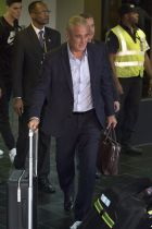 Brazil's coach Tite arrives at the Tom Jobim international airport in Rio de Janeiro, Brazil, Sunday, July 8, 2018. Brazil lost the quarterfinal match against Belgium and leave the soccer World Cup. (AP Photo/Leo Correa)