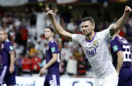 Emirates's Al Ain Marcus Berg, second right, celebrates after Argentina's River Plate Javier Pinola, right, scores an own goal during the Club World Cup semifinal soccer match between Al Ain Club and River Plate at the Hazza Bin Zayed stadium in Al Ain, United Arab Emirates, Tuesday, Dec. 18, 2018. (AP Photo/Hassan Ammar)