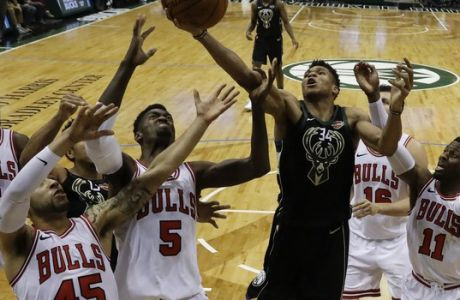 Milwaukee Bucks' Giannis Antetokounmpo shoots in traffic during the second half of an NBA basketball game against the Chicago Bulls Friday, Dec. 15, 2017, in Milwaukee. The Bulls won 115-109. (AP Photo/Morry Gash)