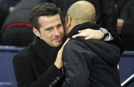 Watford's manager Marco Silva, left, greets Manchester City's manager Pep Guardiola ahead of the English Premier League soccer match between Manchester City and Watford at Etihad stadium, in Manchester, England, Tuesday, Jan. 2, 2018. (AP Photo/Rui Vieira)