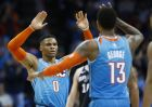 Oklahoma City Thunder guard Russell Westbrook (0) celebrates with Paul George (13) during the second half of the team's NBA basketball game against the San Antonio Spurs in Oklahoma City, Saturday, Jan. 12, 2019. (AP Photo/Sue Ogrocki)