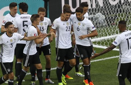 Team Germany celebrate after Mario Gomez (23) scored his side's second goal during the Euro 2016 round of 16 soccer match between Germany and Slovakia, at the Pierre Mauroy stadium in Villeneuve d'Ascq, near Lille, France, Sunday, June 26, 2016. (AP Photo/Darko Vojinovic)