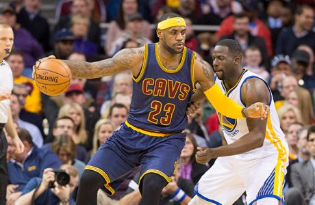 CLEVELAND, OH - FEBRUARY 26: LeBron James #23 of the Cleveland Cavaliers posts up against Draymond Green #23 of the Golden State Warriors during the first half at Quicken Loans Arena on February 26, 2015 in Cleveland, Ohio. NOTE TO USER: User expressly acknowledges and agrees that, by downloading and or using this photograph, User is consenting to the terms and conditions of the Getty Images License Agreement. (Photo by Jason Miller/Getty Images)