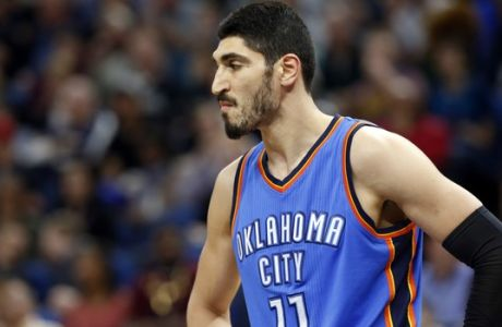 Oklahoma City Thunder's Enes Kanter of Turkey plays during the second half of an NBA basketball game against the Minnesota Timberwolves Tuesday, April 11, 2017, in Minneapolis. (AP Photo/Jim Mone)