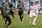Santos' Neymar, right, controls the ball against Corinthians during the final match of the Sao Paulo State soccer league in Santos, Brazil, Sunday, May 19, 2013. Corinthians won 3-2 on aggregate and wins the Sao Paulo State championship. (AP Photo/Andre Penner)