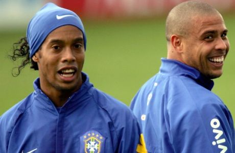 Brazil's strikers Ronaldinho, left, chats with his teammate Ronaldo during a training session at the Thermoplan arena in Weggis, central Switzerland, Friday, June 2, 2006. Brazil will play against Australia, Croatia and Japan in Group F at the upcoming 2006 Soccer World Cup in Germany. (AP Photo/Fernando Llano)