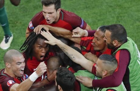 Portugal's Renato Sanches, left, celebrates with his teammates after scoring during the Euro 2016 quarterfinal soccer match between Poland and Portugal, at the Velodrome stadium in Marseille, France, Thursday, June 30, 2016. (AP Photo/Michael Sohn)