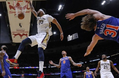 New Orleans Pelicans forward Anthony Davis (23) dunks between New York Knicks forward Michael Beasley (8), center Kyle O'Quinn, left, and guard Ron Baker (31) during the first half of an NBA basketball game in New Orleans, Saturday, Dec. 30, 2017. (AP Photo/Jonathan Bachman)