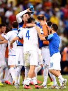 FORTALEZA, BRAZIL - JUNE 24:  Konstantinos Manolas of Greece celebrates with teammates after defeating the Ivory Coast 2-1 during the 2014 FIFA World Cup Brazil Group C match between Greece and the Ivory Coast at Castelao on June 24, 2014 in Fortaleza, Brazil.  (Photo by Jamie McDonald/Getty Images)