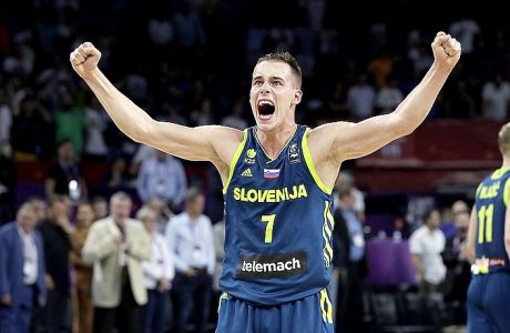 Slovenia's Klemen Prepelic celebrates at the end of their Eurobasket European Basketball Championship semifinal match against Spain in Istanbul, Thursday, Sept. 14, 2017. Slovenia won 92-72. (AP Photo/Thanassis Stavrakis)