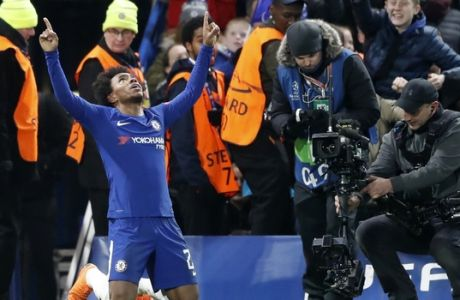 Chelsea's Willian celebrates after scoring the opening goal of his team during the Champions League, round of 16, first-leg soccer match between Chelsea and Barcelona at Stamford Bridge stadium, Tuesday, Feb. 20, 2018. (AP Photo/Frank Augstein)