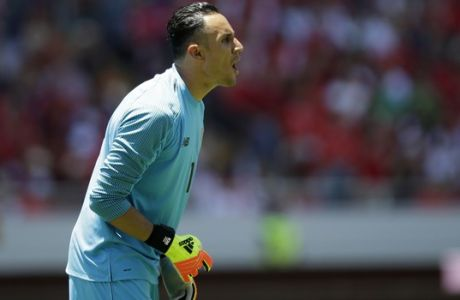 Costa Rica goalkeeper Keylor Navas gives instructions to teammates during a friendly soccer match againts Northern Ireland in San Jose, Costa Rica, Sunday, June 3, 2018. (AP Photo/Moises Castillo)