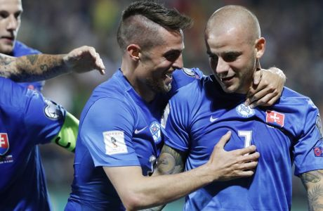 Slovakia's Vladimir Weiss, right, and Robert Mak celebrates scoring a goal during the World Cup Group F qualifying soccer match between Lithuania and Slovakia at LFF stadium in Vilnius, Lithuania, Saturday, June 10, 2017. (AP Photo/Mindaugas Kulbis)