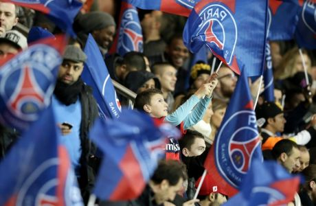 PSG supporters wave their team's flag during the French L1 football match Paris Saint-Germain (PSG) vs Nantes (FCNA), on January 19, 2014 at the Parc des Princes in Paris. AFP PHOTO / KENZO TRIBOUILLARD        (Photo credit should read KENZO TRIBOUILLARD/AFP/Getty Images)