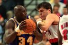 Portland Trail Blazers center Arvydas Sabonis, right, leans in on Los Angeles Lakers' Shaquille O'Neal during game three first-round playoff action in Portland, Ore., Wednesday, April 20, 1997.(AP Photo/Jack Smith)