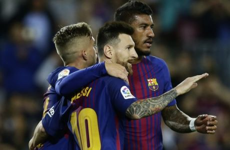 FC Barcelona's Lionel Messi celebrates after scoring during the Spanish La Liga soccer match between FC Barcelona and Eibar at the Camp Nou stadium in Barcelona, Spain, Tuesday, Sept. 19, 2017. (AP Photo/Manu Fernandez)
