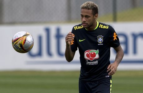 Brazil's Neymar trains during a practice session of the national team in preparation for an upcoming World Cup qualifying match, in Teresopolis, Brazil, Tuesday, Oct. 3, 2017. (AP Photo/Silvia Izquierdo)