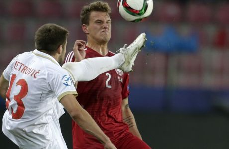 Serbia's Nemanja Petrovic, left and Denmarks Alexander Scholz challenge for the ball during the Euro U21 soccer championship group A match between Denmark and Serbia, at the Letna stadium in Prague, Czech Republic, Tuesday, June 23, 2015. (AP Photo/Petr David Josek)