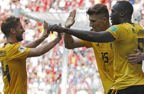 Belgium's Romelu Lukaku, right, celebrates with teammates Dries Mertens, left, and Thomas Meunier after scoring their team's third goal during the group G match between Belgium and Tunisia at the 2018 soccer World Cup in the Spartak Stadium in Moscow, Russia, Saturday, June 23, 2018. (AP Photo/Antonio Calanni)