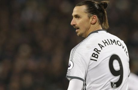 Manchester Uniteds Zlatan Ibrahimovic watches play during their English Premier League soccer match between West Ham United and Manchester United at the London stadium, in London Monday, Jan.  2,  2017. (AP Photo/Alastair Grant)