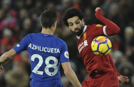 Liverpool's Mohamed Salah, right, and Chelsea's Cesar Azpilicueta during the English Premier League soccer match between Liverpool and Chelsea at Anfield, Liverpool, England, Saturday, Nov. 25, 2017. (AP Photo/Rui Vieira)