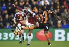 Burnley's Ashley Westwood, left, and Hull City's Dieumerci Mbokani fight for the ball during the English Premier League soccer match between Hull & Burnley at the KCOM stadium, Hull, England. Saturday, Feb. 25, 2017 (Mike Egerton/PA via AP)