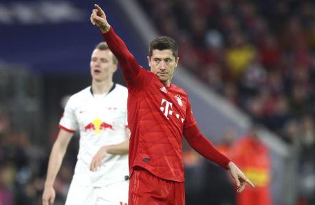 Bayern's Robert Lewandowski reacts during the German Bundesliga soccer match between Bayern Munich and RB Leipzig at the Allianz Arena in Munich, Germany, Sunday, Feb. 9, 2020. (AP Photo/Matthias Schrader)