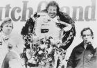 Mario Andretti is wreathed in smiles and laurels as he holds the trophy after winning the Formula One event of the Dutch Grand Prix at Zandvoort, Netherlands, Aug. 27, 1978. Sweden's Ronnie Peterson, who finished second, is at left, and Austria's Niki Lauda, who finished third, is at right. (AP Photo)