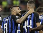 Inter Milan's Ivan Perisic, right, celebrates with his teammate Mauro Icardi after scoring during a Serie A soccer match between Inter Milan and Torino, at the San Siro stadium in Milan, Italy, Sunday, Aug. 26, 2018. (AP Photo/Luca Bruno)