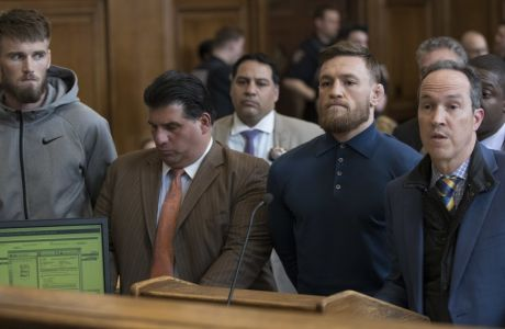 CORRECTS TO BROOKLYN CRIMINAL COURT, NOT BROOKLYN FEDERAL COURT-Ultimate fighting star Conor McGregor, foreground second right, is arraigned in Brooklyn Criminal Court, Friday, April 6, 2018 in New York. McGregor is facing criminal charges in the wake of a backstage melee he allegedly instigated that has forced the removal of three fights from UFC's biggest card of the year. Video footage appears to show the promotion's most bankable star throwing a hand truck at a bus full of fighters after a Thursday news conference for UFC 223 at Brooklyn's Barclays Center. (AP Photo/Mary Altaffer, Pool)