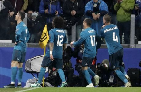 Real Madrid's Cristiano Ronaldo, left, celebrates after scoring the second goal of his team during the Champions League, round of 8, first-leg soccer match between Juventus and Real Madrid at the Allianz stadium in Turin, Italy, Tuesday, April 3, 2018. (AP Photo/Luca Bruno)