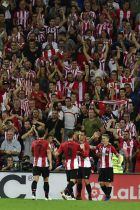 Athletic Bilbao's Iker Muniain, right, celebrates his goal with teammates during the Spanish La Liga soccer match between Athletic Bilbao and Real Madrid at San Mames stadium, in Bilbao, northern Spain, Saturday, Sept. 15, 2018.(AP Photo/Alvaro Barrientos)