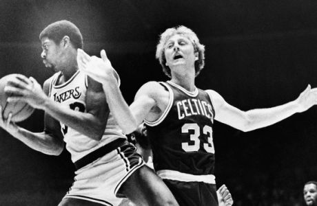 "Los Angeles Lakers Earvin ""Magic"" Johnson (32) rips a rebound from the hands of Boston Celtics Larry Bird (33) during the first half, Dec. 28, 1979 in Los Angeles. It was the first time both former NCAA stars met in combat since last year's NCAA Tournament. (AP Photo)"