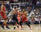 Toronto Raptors guard Kyle Lowry (7) holds the ball against Washington Wizards guard Austin Rivers (1) during the first half of an NBA basketball game, Saturday, Oct. 20, 2018, in Washington. Also seen is Raptors center Jonas Valanciunas at left. (AP Photo/Nick Wass)