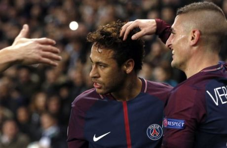 PSG's Neymar, left, celebrates after scoring his side's second goal with his teammate, Marco Verratti, during a Champions League Group B soccer match between Paris St. Germain and Celtic at the Parc des Princes stadium in Paris, France, Wednesday, Nov. 22, 2017. Banner in the middle reads : Never alone. (AP Photo/Christophe Ena)