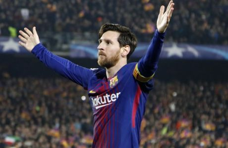 Barcelona's Lionel Messi celebrates after scoring his side's third goal during the Champions League round of sixteen second leg soccer match between FC Barcelona and Chelsea at the Camp Nou stadium in Barcelona, Spain, Wednesday, March 14, 2018. (AP Photo/Emilio Morenatti)