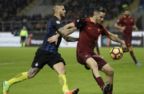 Inter Milan's Mauro Icardi,left, and Roma's Kostas Manolas vie for the ball during an Italian Serie A soccer match between Inter Milan and Roma, at the San Siro stadium in Milan, Italy, Sunday, Feb. 26, 2017. (AP Photo/Luca Bruno)